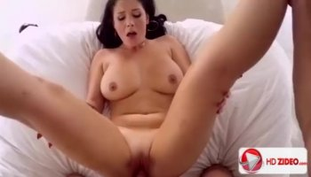 An Asian couple getting it on in the bed room